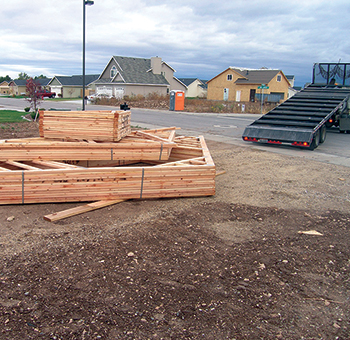 Trusses dropped off by trailer at a residential building location