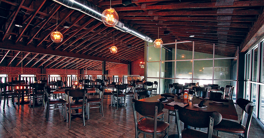Interior of the new Vintage restaurant in Sauk City, showing visible roof trusses in the ceiling