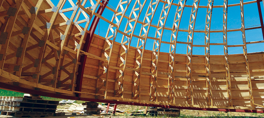 A dome made of wood uses an innovative truss arch approach