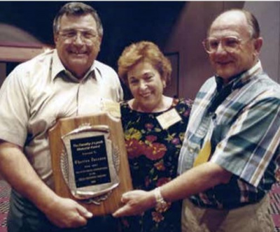 "Charlie with his wife Dolores in 1996 as he receives an award from Terry Burcaw of 41 Truss for SETMA's  ""Outstanding Contributions to the Building Component Industry"""