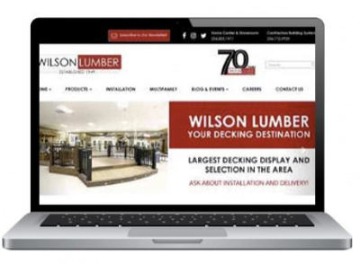 Laptop with Wilson Lumber website on the screen