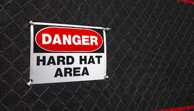 Sign that reads Danger Hard Hat Area