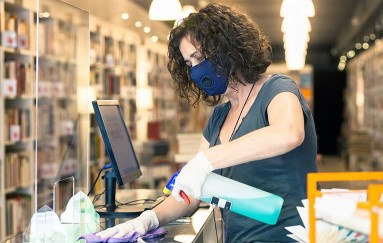 A woman cleaning a store counter