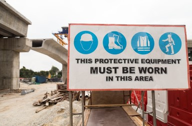 A sign about wearing protective equipment in that work area