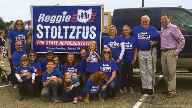 Group of people from Reggie's campaign in front of a truck with a banner promoting him for state representative