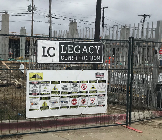 Safety banner hanging at a Legacy Construction jobsite
