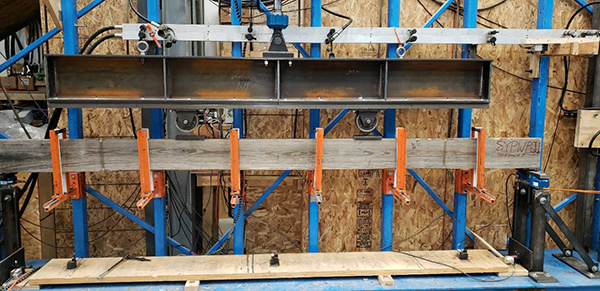 A joist in the process of being tested