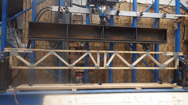 Trusses being preloaded to design load